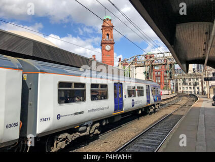 Delayed Electric Northern Railway EMU train at Manchester Oxford Road Railway station, North West England, UK - Stock Photo