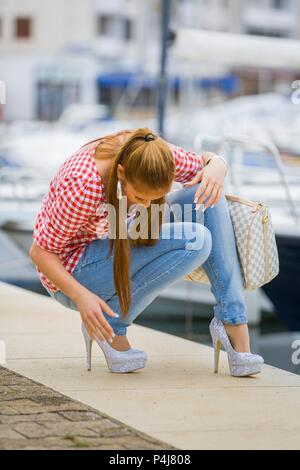 Teenager female wearing stiletto high heels shoes - Stock Photo