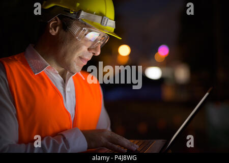 Handsome Persian man construction worker at the construction sit - Stock Photo