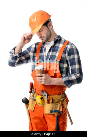 Repairman in orange overall and helmet holding coffee cup isolated on white - Stock Photo