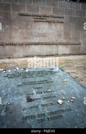 Marker stone for Homosexuals, Sinti-Roma, Jewish and Jehovah Witness killed in Bergen-Belsen, Germany - Stock Photo