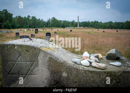 The weathered  and bearing the Star of David at graves in the memorial grounds of Bergen-Belsen concentration camp.. - Stock Photo