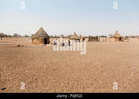 Himba village with traditional huts near Etosha National Park in Namibia, Africa - Stock Photo