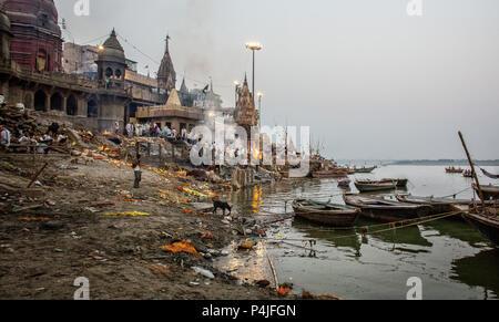 Hindu cremation ceremony at Manikarnika Ghat on banks of holy Ganges river at Varanasi Uttar Pradesh India - Stock Photo