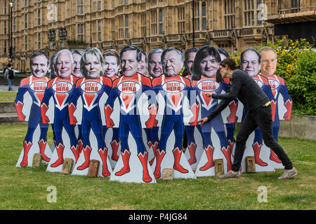 15 superhero cutouts with faces of key Tory rebel MPs outside Parliament ahead of Wednesday's Commons vote to give Parliament a vote on Brexit. - Stock Photo