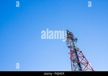 Technology on the top of the telecommunication tower copy space.Cellular phone antennas.Telecommunication mast television antennas.Development communication system - Stock Photo