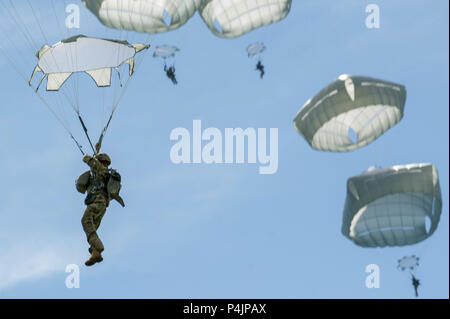 Paratroopers assigned to the 4th Infantry Brigade Combat Team (Airborne), 25th Infantry Division, U.S. Army Alaska, conduct an airborne proficiency operation on Malemute drop zone at Joint Base Elmendorf-Richardson, Alaska, June 13, 2018, during Exercise Arctic Aurora with Japan Ground Self-Defense Force Soldiers. Arctic Aurora is a bilateral training exercise involving elements of the Spartan Brigade and the JGSDF, which focuses on strengthening ties between the two by executing combined small unit airborne proficiency operations and basic small arms marksmanship. (U.S. Air Force photo by Jus - Stock Photo