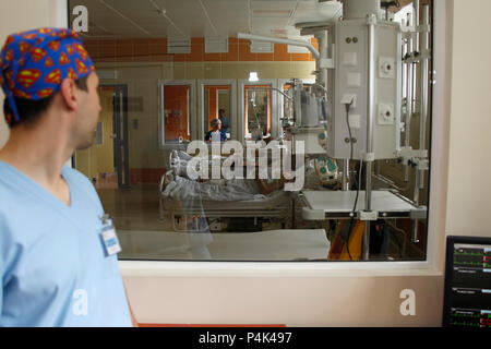 Belarus, Gomel, June 01, 2017, Central Hospital, Department of Reanimation. The doctor looks at the sick in the hospital.Patients on the verge of deat - Stock Photo