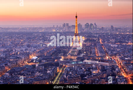 PARIS - FEBRUARY 7: Eiffel Tower brightly illuminated at dusk on FEBRUARY 7, 2015 in Paris. The Eiffel tower is the most visited monument of France. - Stock Photo