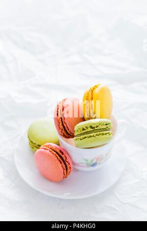Assorted Colorful Macarons in a Tea Cup - Stock Photo