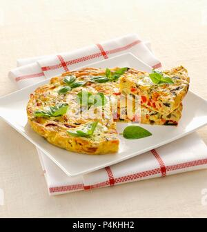 Colourful vegetable frittata with basil - Stock Photo