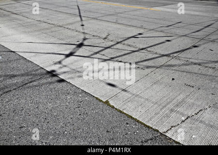 shadows electricity on a road - Stock Photo