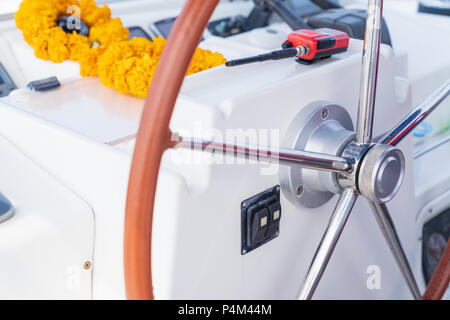 Modern sailing yacht steering wheels, vacation holidays concept yachts in the sea, luxury summer cruise. - Stock Photo
