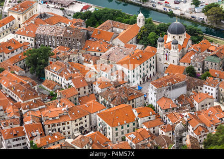 Aerial drone view of the tiled roofs of houses in Kotor old town, Montenegro. Natural and Historical Region of Kotor is a UNESCO World Heritage Site - Stock Photo