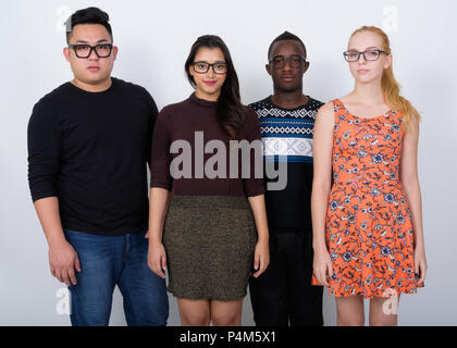 Studio shot of diverse group of multi ethnic friends wearing eye - Stock Photo