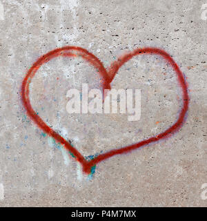 Texture of a concrete wall with a painted heart. Drawing a heart on a concrete wall can be used for postcards. - Stock Photo
