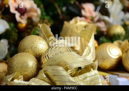 Photo of luxury gift boxes under Christmas tree, New Year home decorations, golden wrapping of Santa presents, festive fir tree decorated with garland - Stock Photo