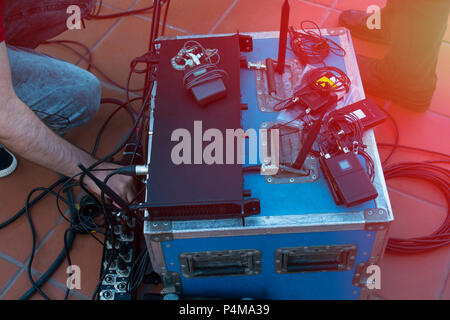 Sound technician and lights technicians control the music show in concert.Professional audio, light mixer controller panel.Pro equipment for concerts. - Stock Photo