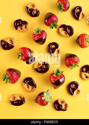 Chocolate strawberries and chocolate pretzels - Stock Photo