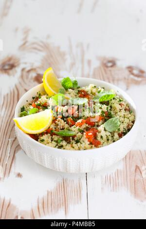Couscous salad with tomatoes and peppermint - Stock Photo