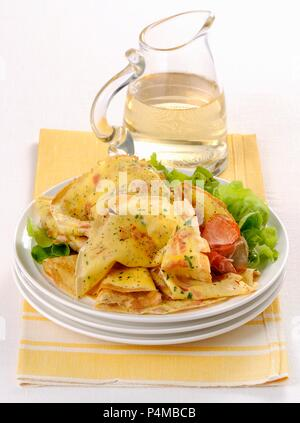 Mini bacon pancakes on a bed of salad - Stock Photo