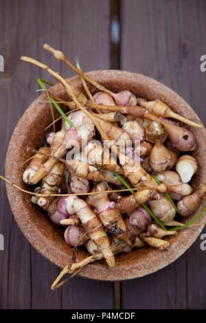 A bowl of Jerusalem artichokes (seen from above) - Stock Photo