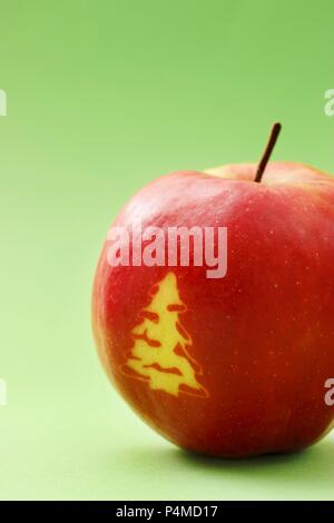 Red apple with a Christmas tree - Stock Photo