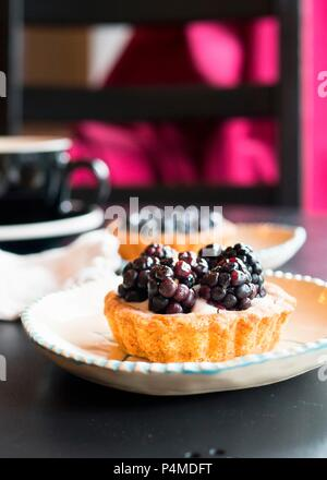 Berry tart dessert at a cafe - Stock Photo