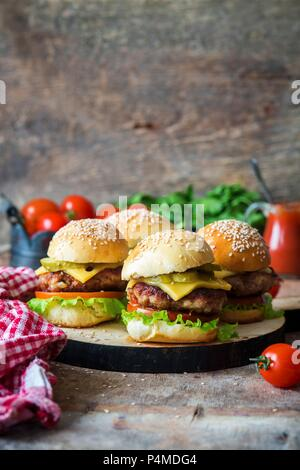 Homemade burgers with pickled cucumbers - Stock Photo