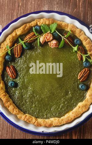 Green tea vegetarian pie match with nuts and mint - Stock Photo