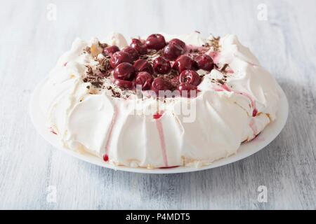 Pavlova with cherries and chocolate - Stock Photo