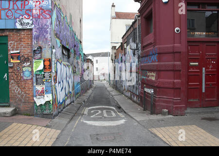 A graffiti covered side street in Stokes Croft, Bristol, England. - Stock Photo