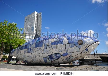 The Big Fish also called The Salmon of Knowledge is a printed ceramic mosaic sculpture by John Kindness. in Belfast, Northern Ireland, Uk. - Stock Photo