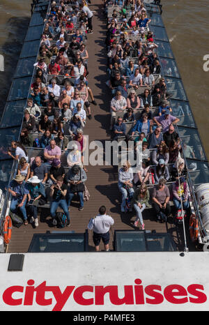 tourists on a river tour boat, London. - Stock Photo