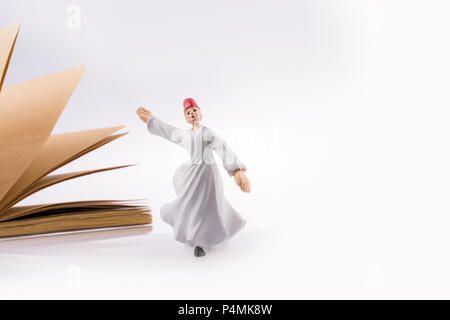 Sufi Dervish on a notebook on white background - Stock Photo