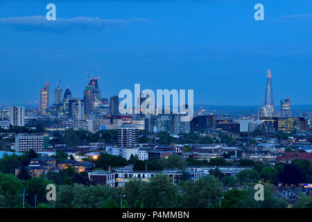 Photographed from the Parliament Hill in 2018  after sunset, glittering  skyscrapers and illuminated St Paul's Cathedral - Stock Photo