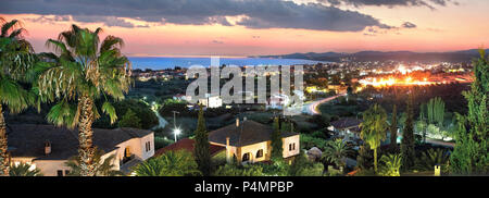 Nikiti town, Chalkidiki,  Greece, top view panorama cityscape in evening with buildings, sea and mountain - Stock Photo