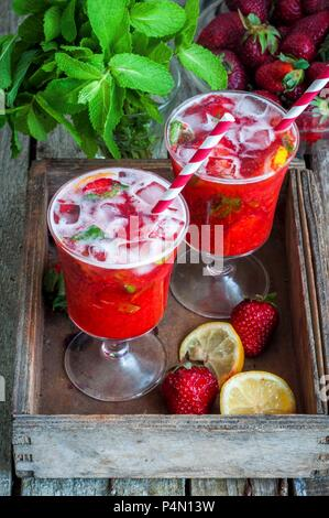 Strawberry lemonade in two glasses with straws - Stock Photo