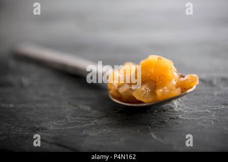 Apple chutney on spoon - Stock Photo