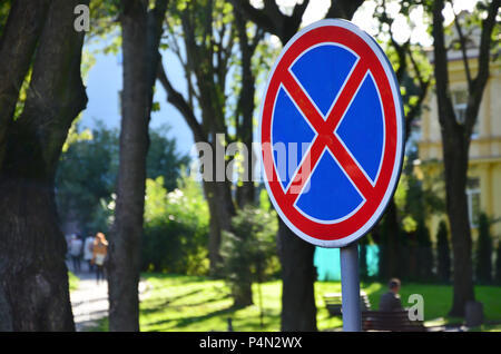 Round road sign with a red cross on a blue background. A sign means a parking prohibition - Stock Photo