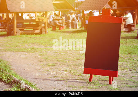 A large board as a menu for an open-air restaurant in a mountainous area. Free space for your text . - Stock Photo