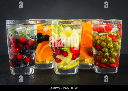 Various detox water in glasses, different tastes, berries, fruits - Stock Photo