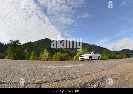 Asphalt road in the mountainous terrain in the morning - Stock Photo