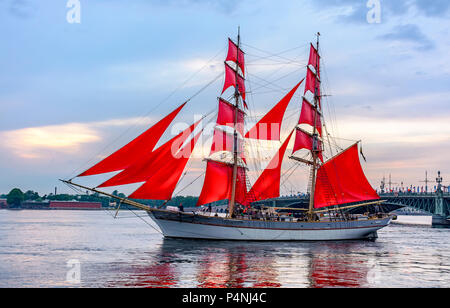 Rehearsal of the passage of the sailing ship on the Neva on the eve of a holiday of graduates 'Scarlet sails' in St. Petersburg. - Stock Photo