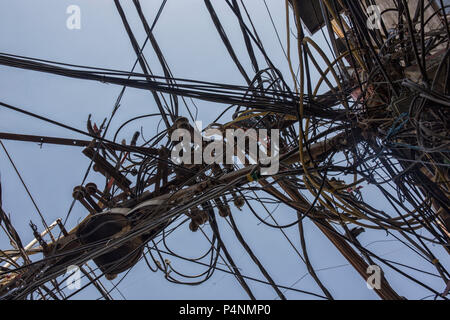 Wires attached to the electric pole, the chaos of cables and wires on an electric pole in New dehli, India, concept of electricity - Stock Photo