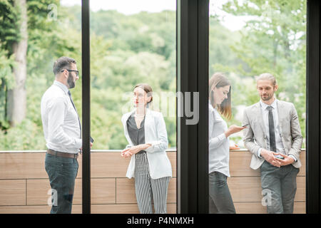 Business people on the office balcony during a break - Stock Photo