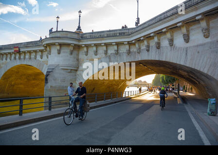 Caucasian Man riding on bicycle through Pont neuf bridge, Paris, IDF, France - Stock Photo