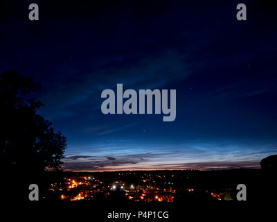 Weather UK: Amazingly bright sunlight on the horizon in the night sky over Ashbourne, Derbyshire after the Summer solstice taken after 1am on Saturday 23rd June 2018 taken facing due North East towards The Peak District National Park Credit: Doug Blane/Alamy Live News - Stock Photo