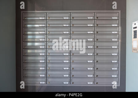 Mailboxes on the wall in the entrance of an apartment building. - Stock Photo