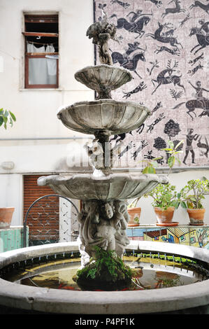 VIETRI SUL MARE, ITALY - April 27, 2018 Decorative fountain in the Italian courtyard in Amalfi Coast - Stock Photo